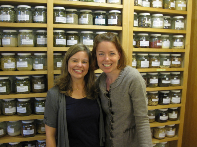 Kate and Jessica with wall of bulk herbs